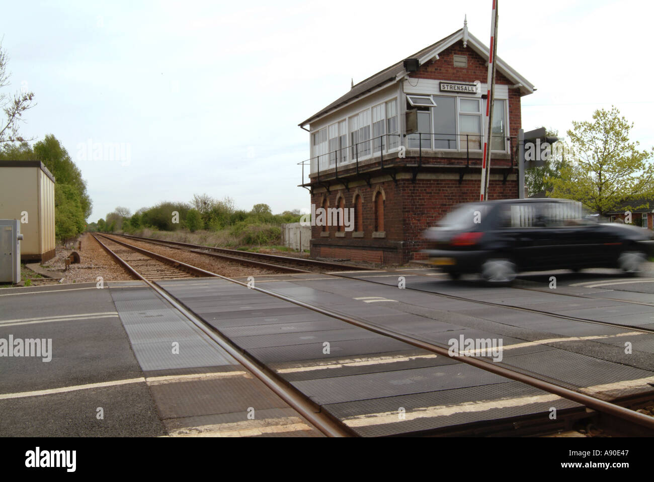 railway crossing level crossing strensall york yorkshire england village car train travel transport - Stock Image