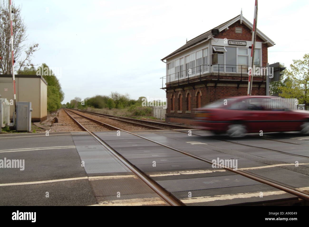 railway crossing level crossing village strensall york yorkshire england village car train travel transport - Stock Image