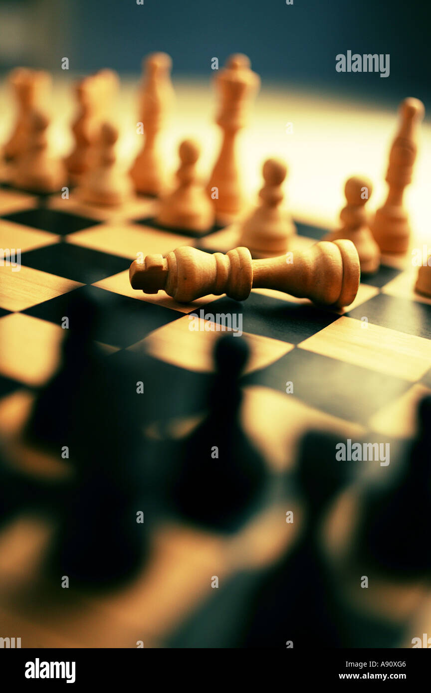 Chess board with white King resigned Stock Photo