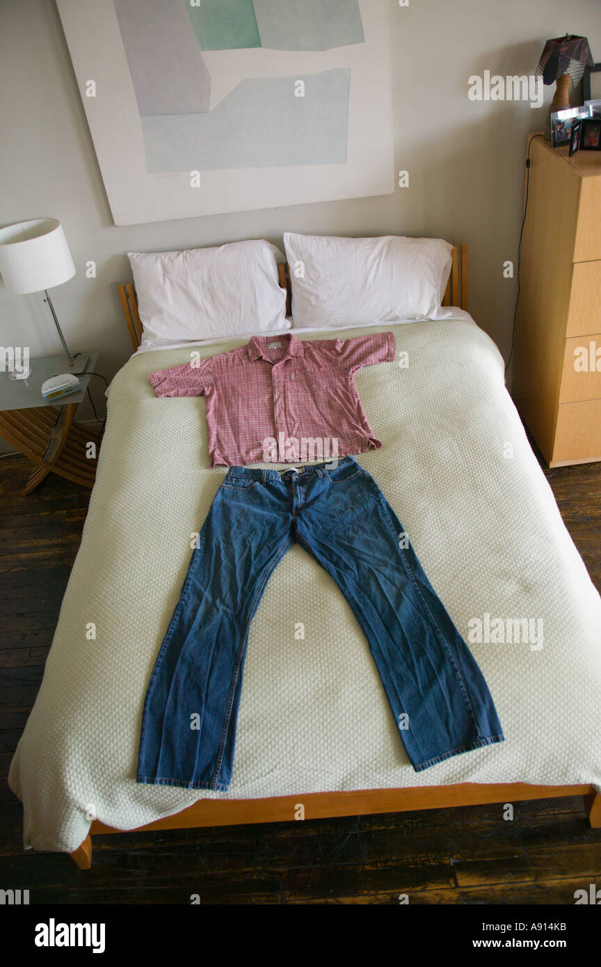Clothes Laid out on Bed - Stock Image