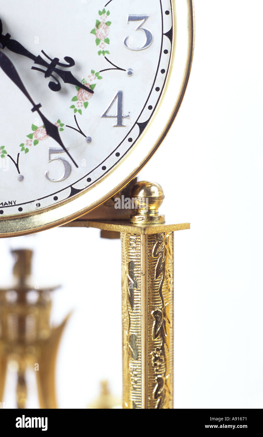 Antique Clock on White Background - Stock Image