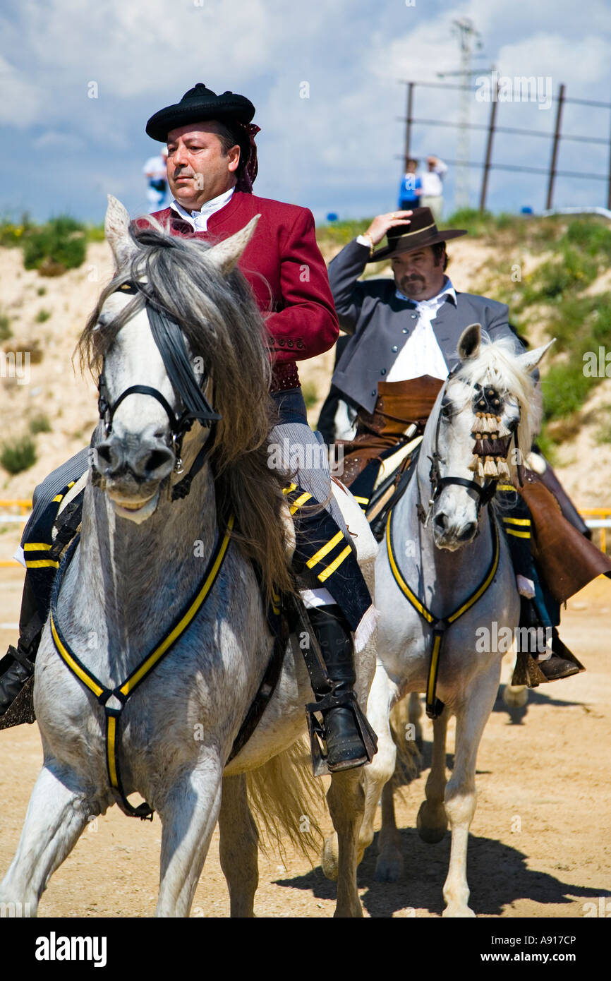 Elegant horseman in traditional spanish costume riding at a local fiesta at El Campello on the Costa Blanca Spain - Stock Image