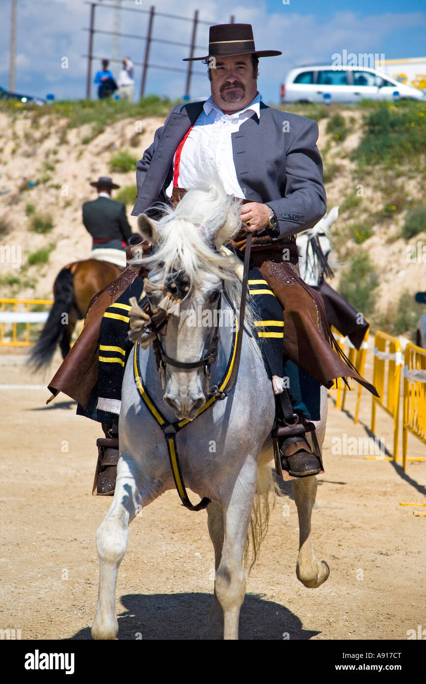 Horseman in traditional spanish costume riding at a local fiesta at El Campello on the Costa Blanca Spain 2007 - Stock Image