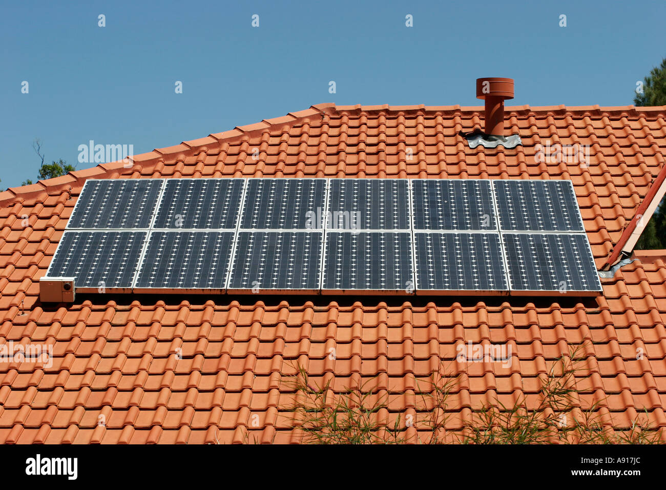 Photovoltaic solar panels on a house roof in Sydney New South Wales Australia. - Stock Image