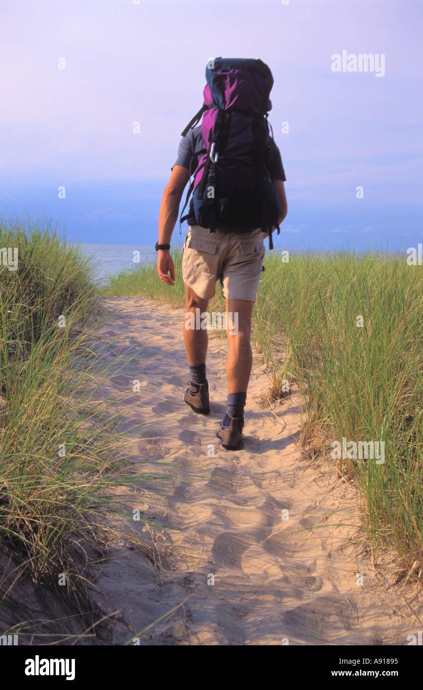 Backpacker along the beach and Lake Michigan at Indiana Dunes National Lakeshore Indiana - Stock Image