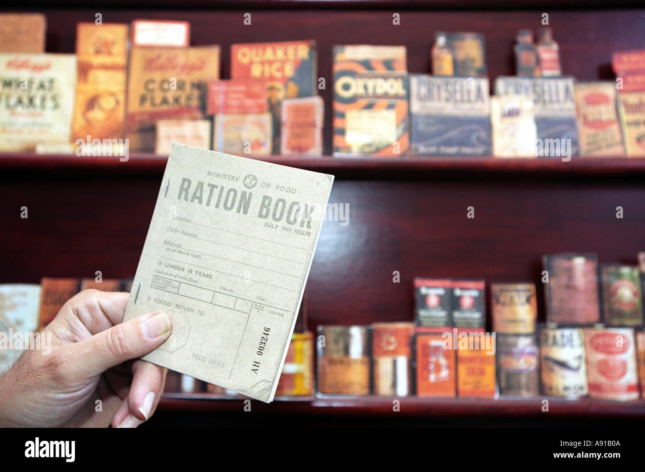 World War 2 ration book with backdrop of that periods foodstuffs - Stock Image