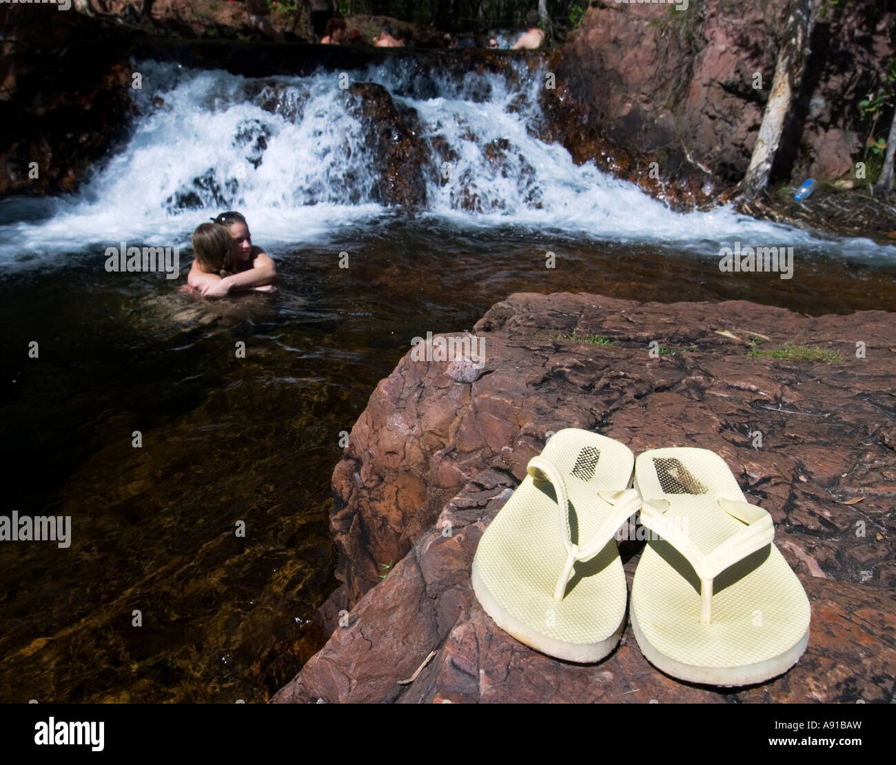 Young backpacker couple in Buley Rockhole pool in Litchfield National Park Northern Territories Australia - Stock Image