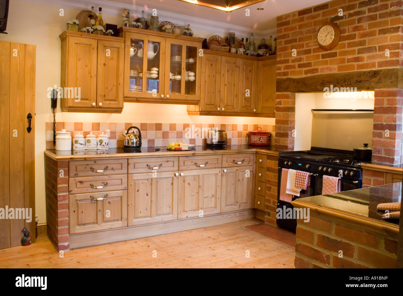 A Country Kitchen In A Farmhouse Wooden Cupboards And Floor With