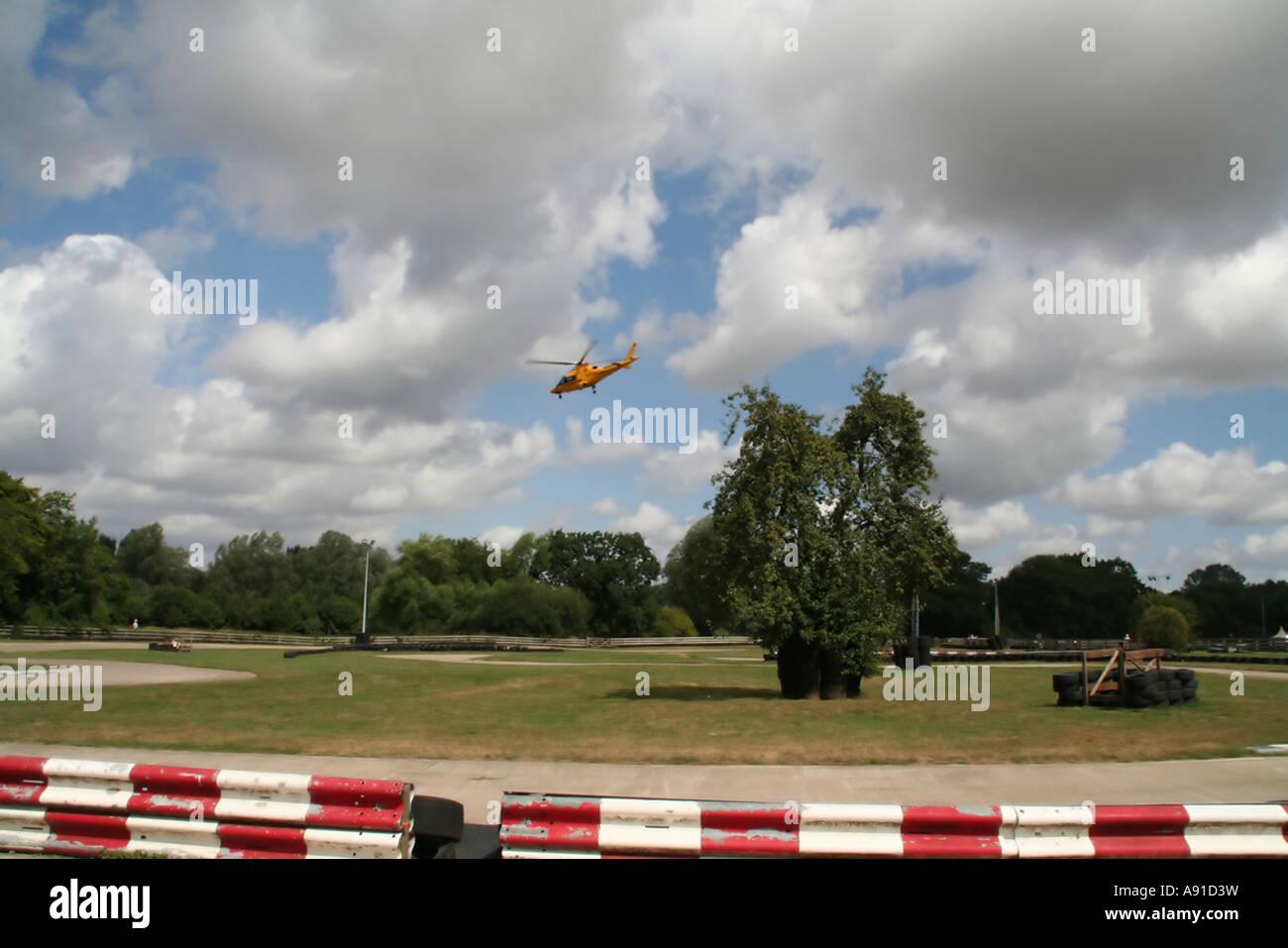An air ambulance at a race circuit - Stock Image