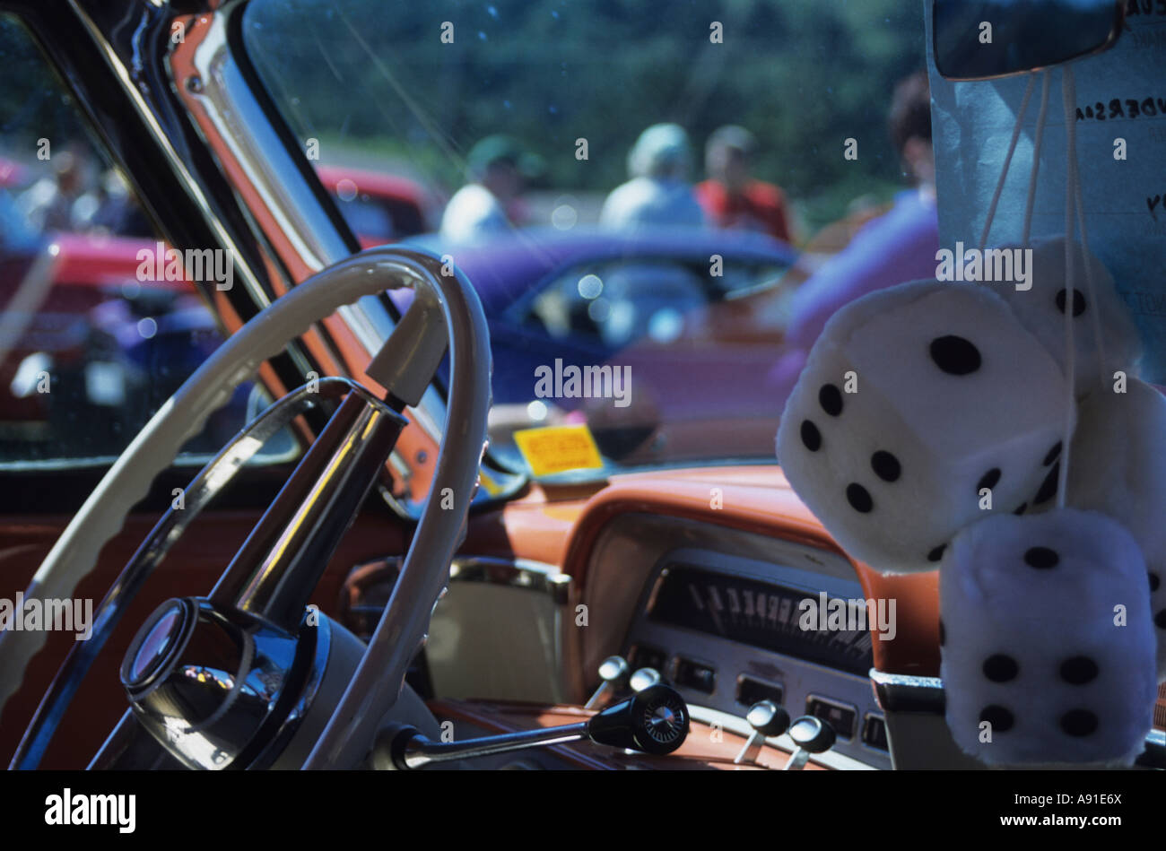 Fluffy dice in vintage car - Stock Image
