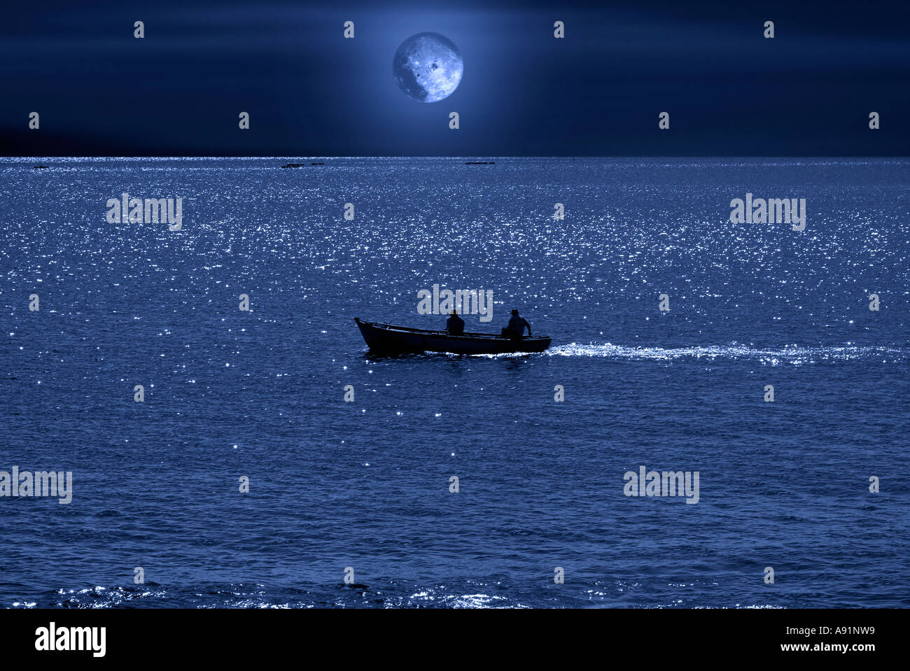 full moon and a fishing boat Vollmond und Meer - Stock Image