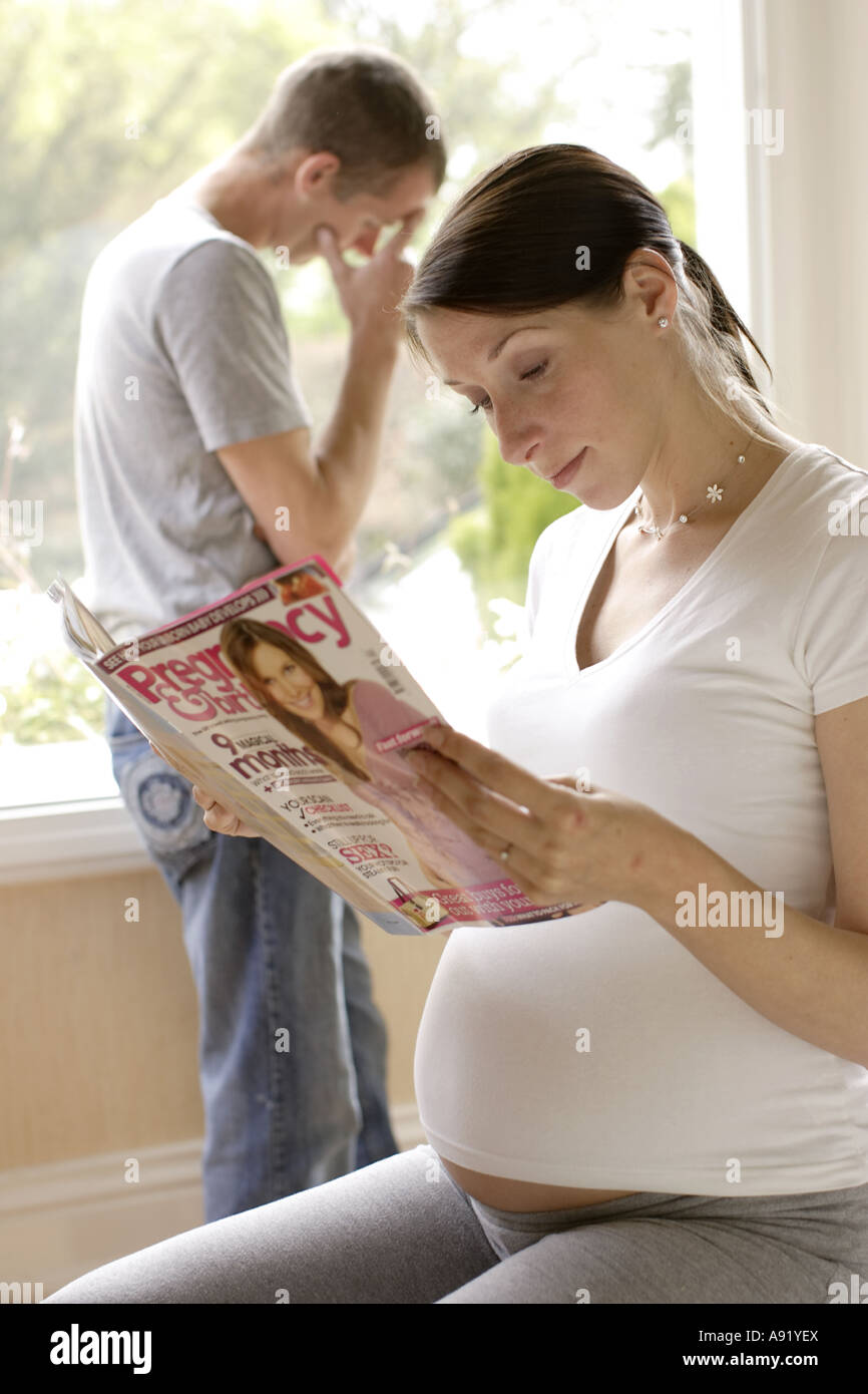 Man stressed about coping with pregnancy - Stock Image