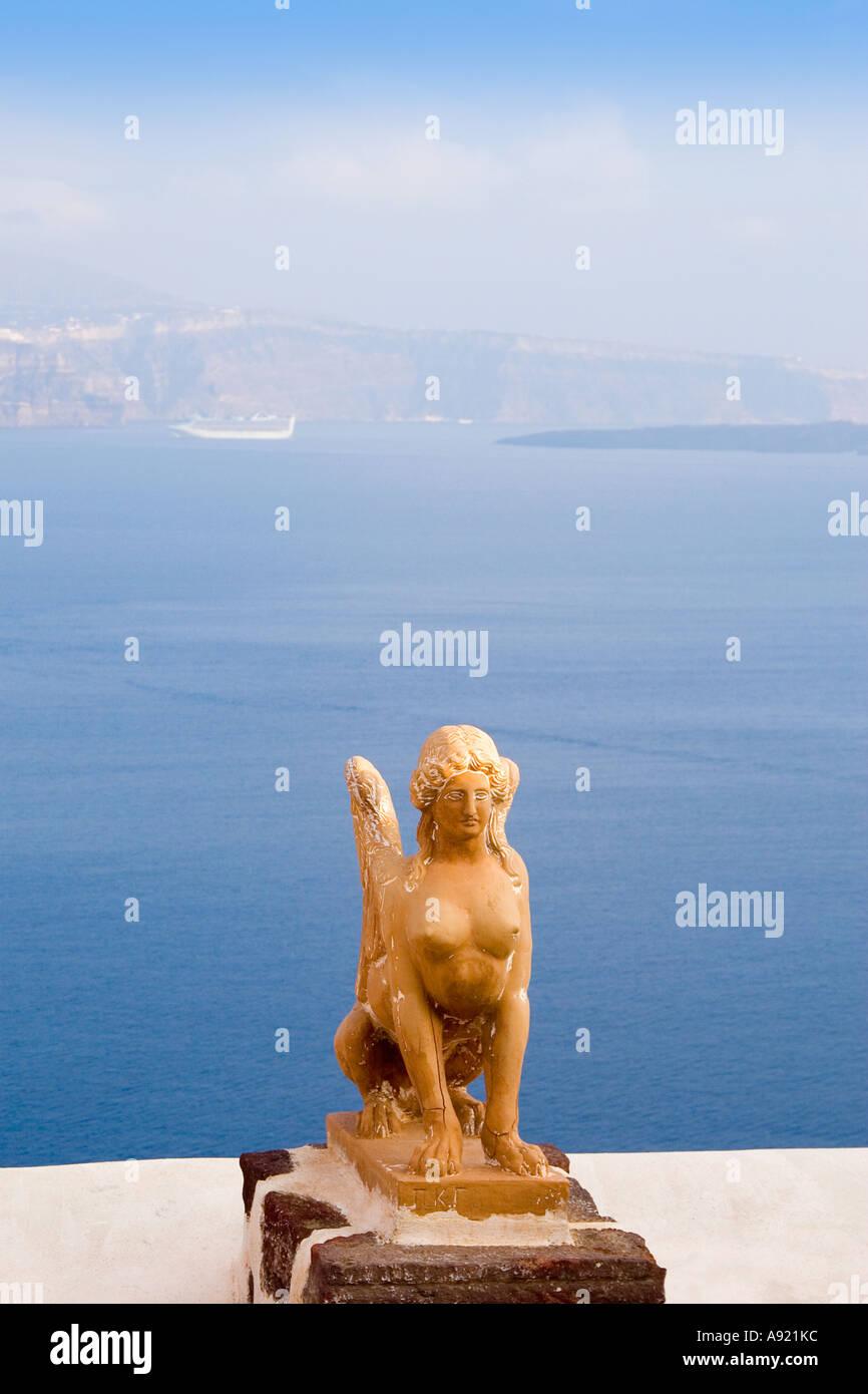 sphinx Ia oia thira fira santorini greek islands greece cyclades mediterranean europe statue sculpture sphinx overlooking sea - Stock Image