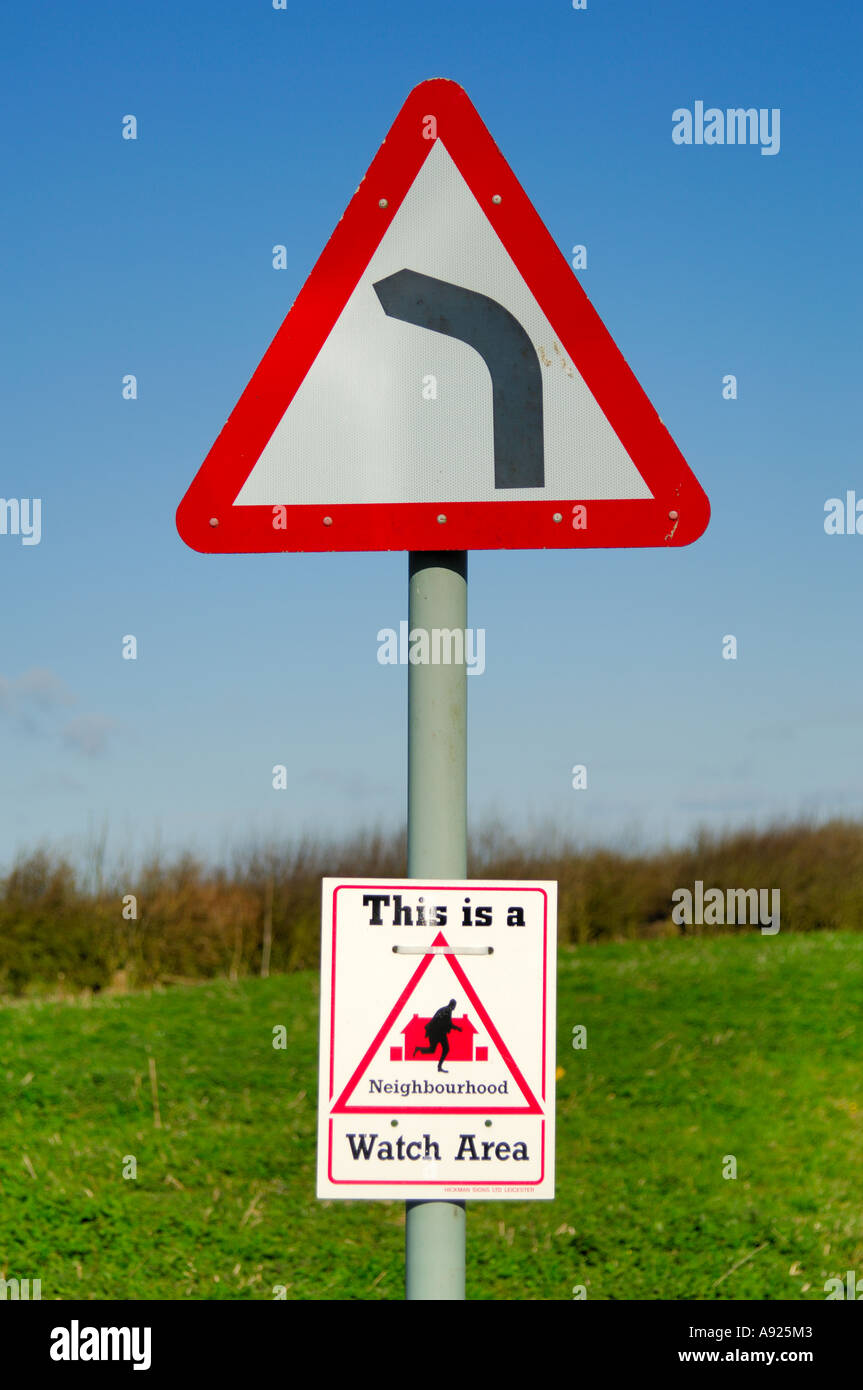 Road Sign For Left Hand Bend With Neighbourhood Watch Below