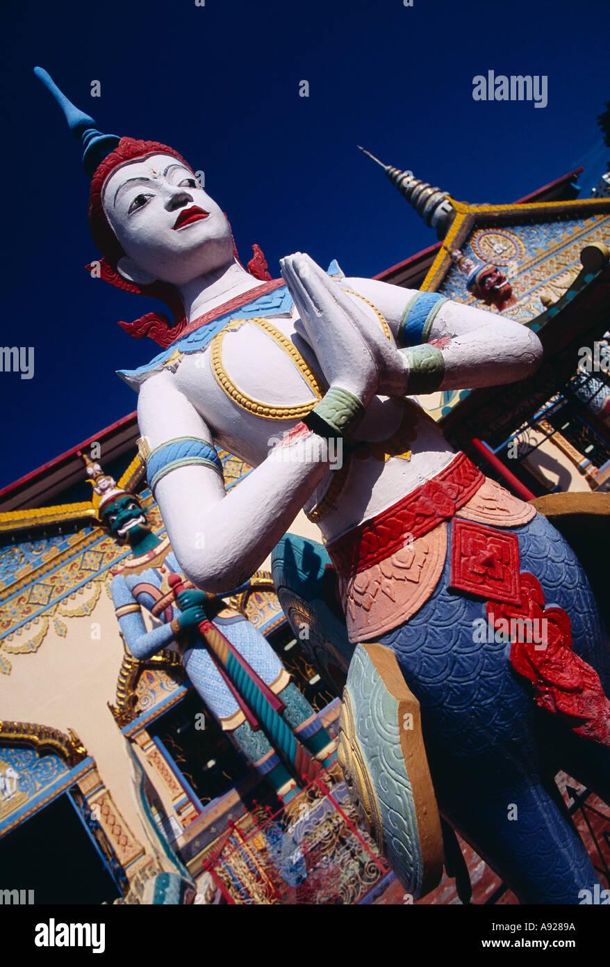 MALAYSIA Penang Georgetown Wat Buppharam or Chayamangkalaram Sleeping Buddha Temple Statues at the entrance of Thai Stock Photo