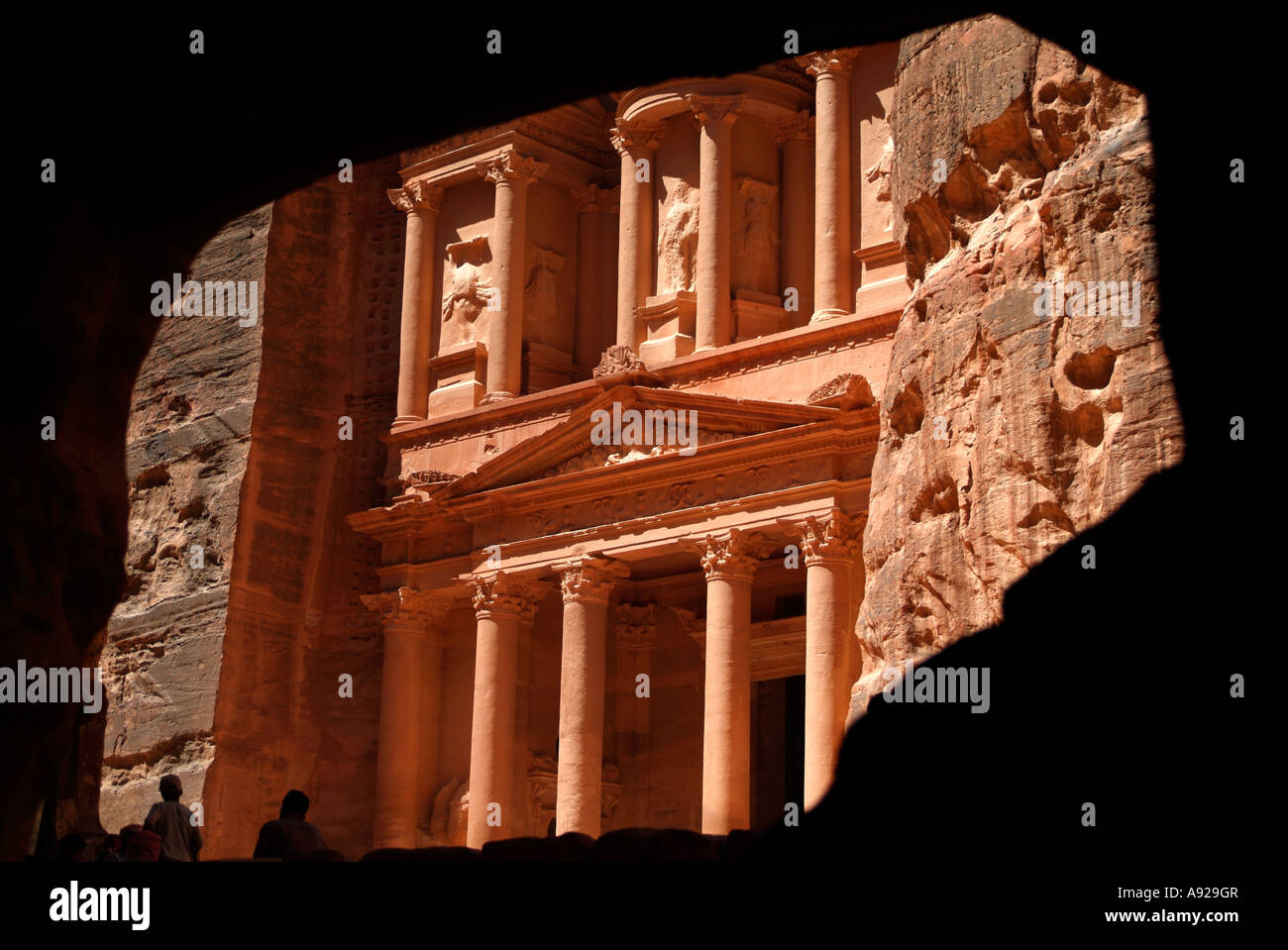 View of the Treasury from inside cave at Petra in Jordan - Stock Image