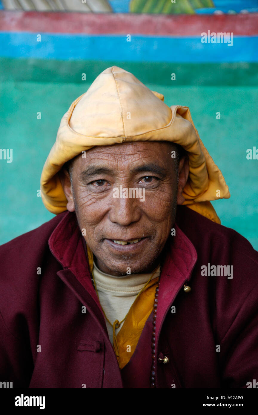 Buddhist monk lama wearing a yellow cap of Sakya-pa sect in the old monastery gompa of Dzong Mustang Annapurna Region - Stock Image