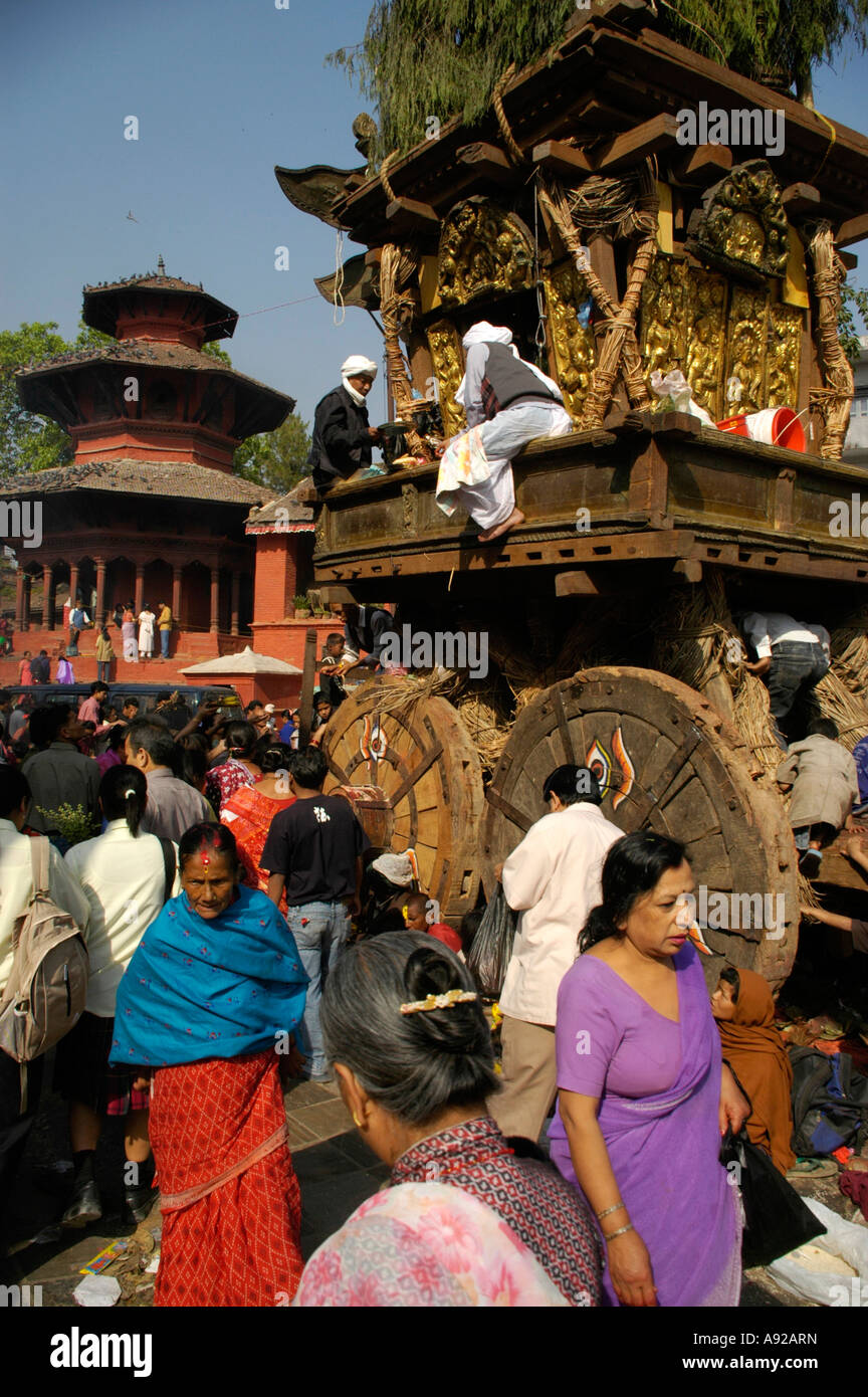 Believers at the chariot of Seto Macchendranath with a temple of Durbar Square Kathmandu Nepal - Stock Image