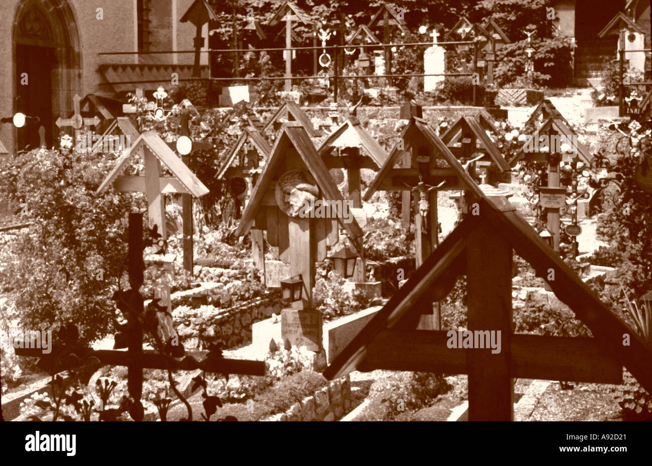 old cemetery with wooden cross cruzifix sepia effekt Austria - Stock Image
