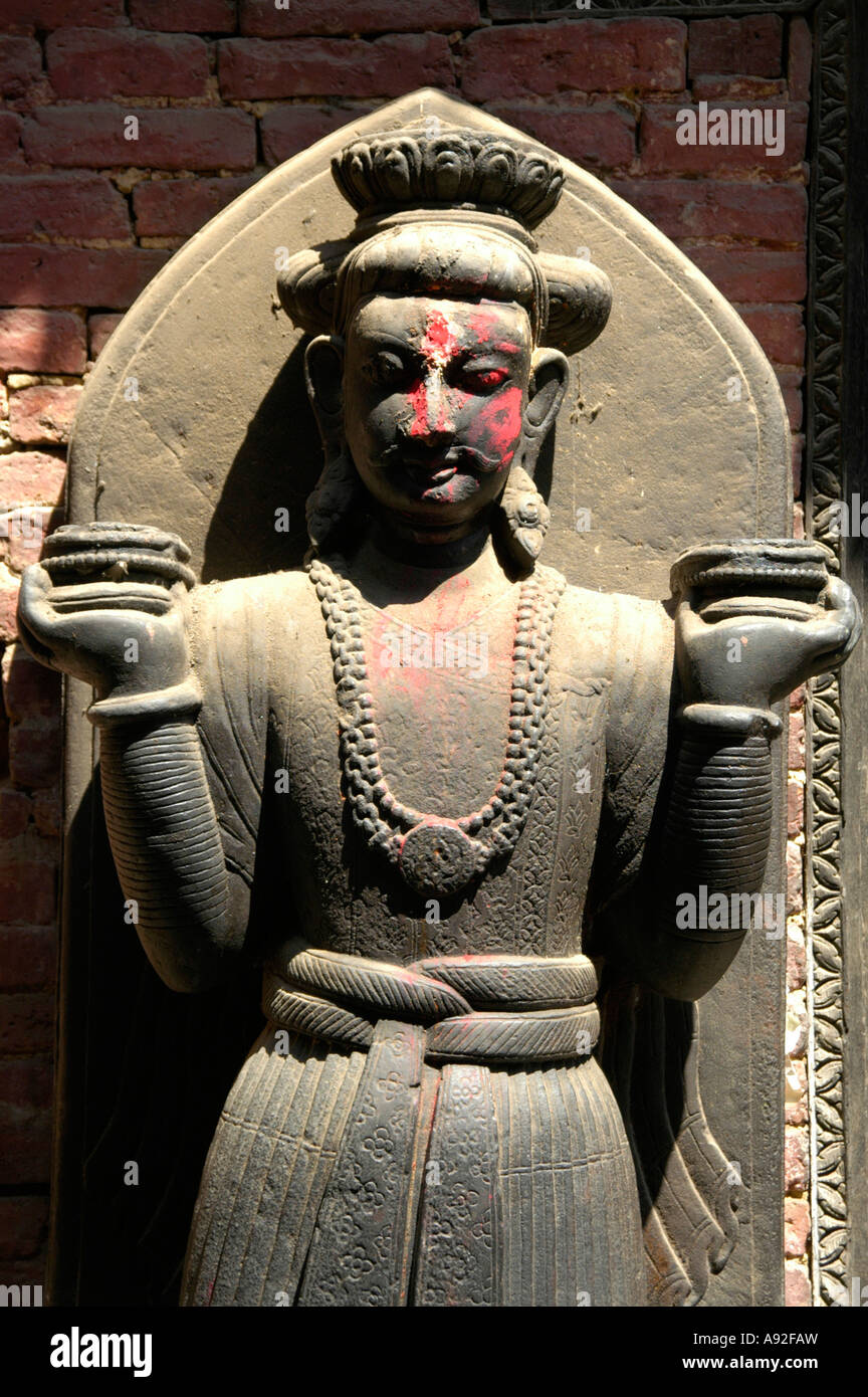 Figure with red coloured cheeks Royal Palace Bhaktapur Nepal - Stock Image