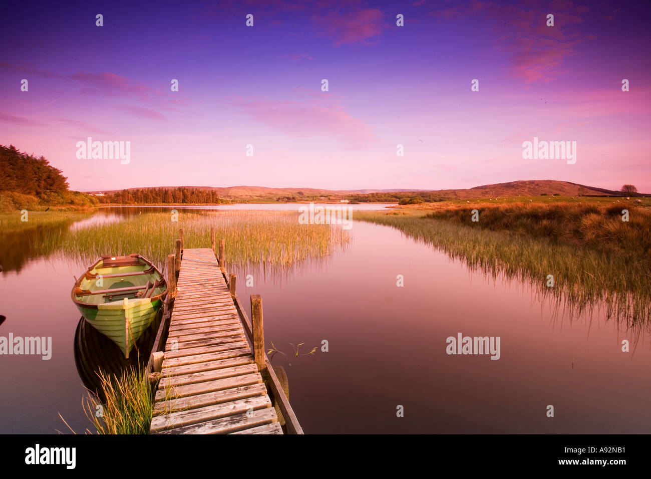 Rowing Boat on small Lough nr Westport Co Mayo Eire - Stock Image