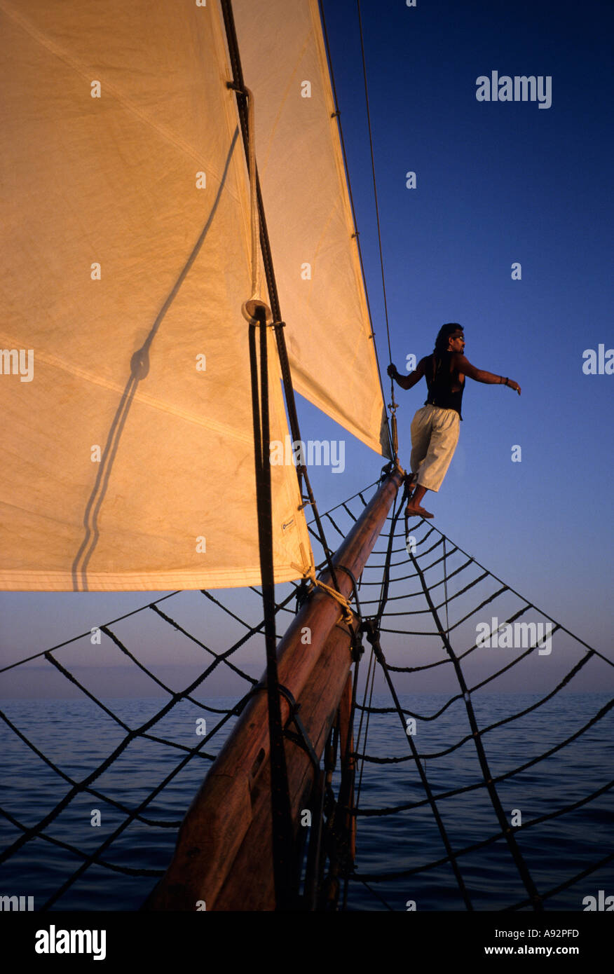 Sailor scans horizon aboard sunset cruise pirate ship Cabo San Lucas Mexico - Stock Image