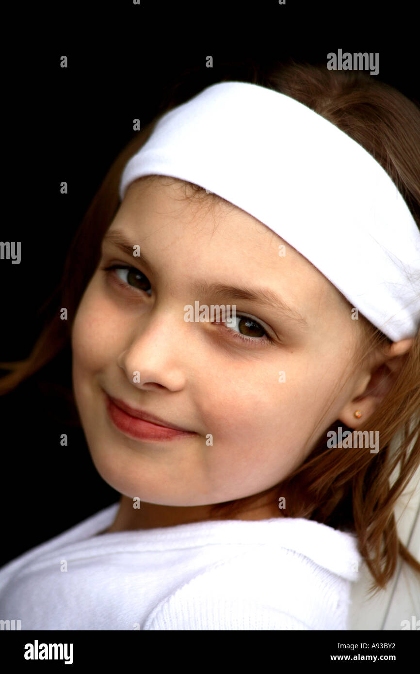 2383485b0be9 Vertical close up portrait of pretty smiling young girl in head band ...