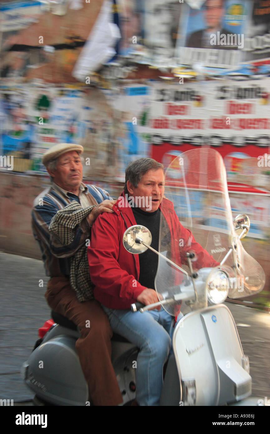 Campania citytour Europe European excursion Exterior holiday Italy men Middle age motion motocycle Outdoors ride - Stock Image
