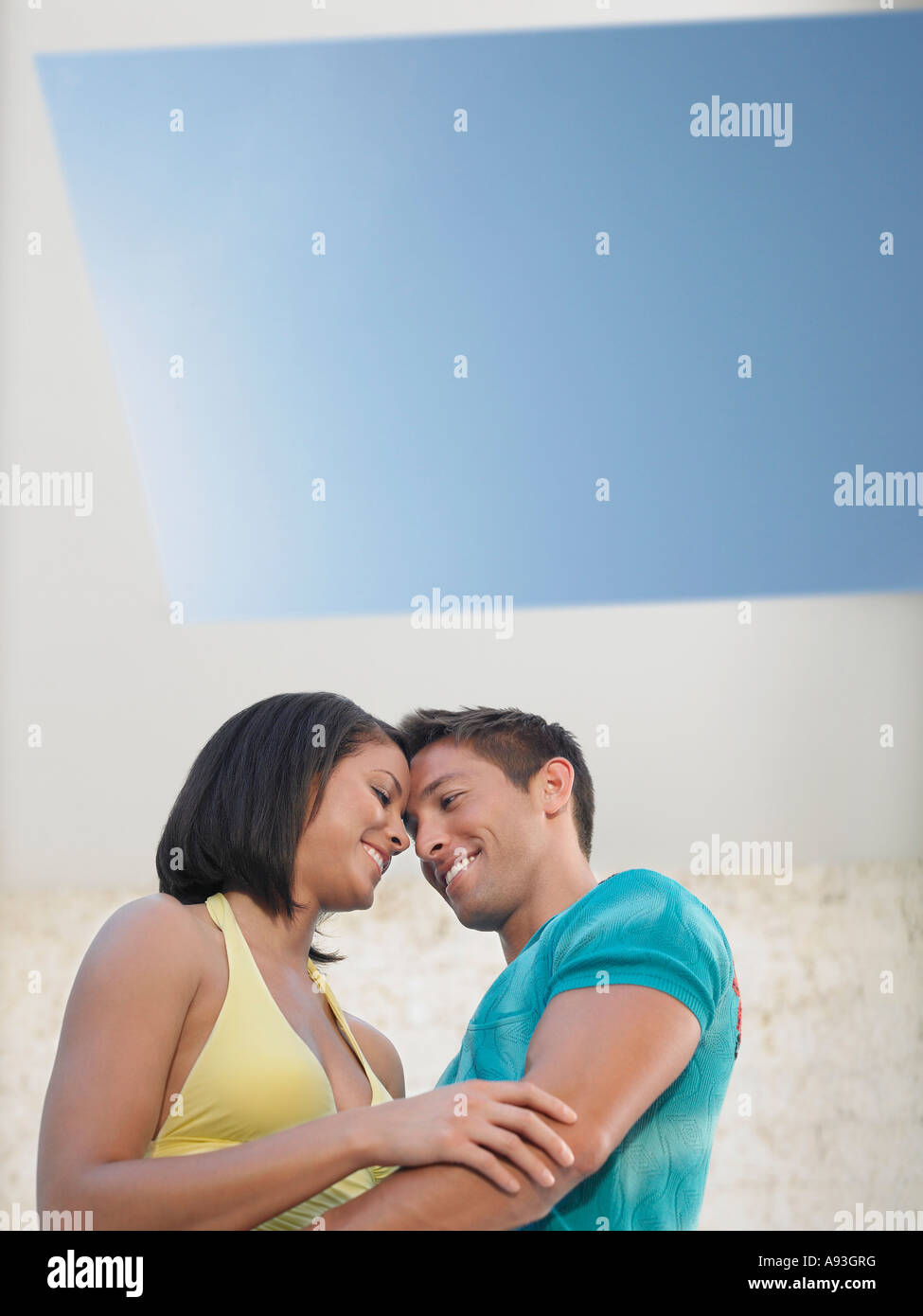 Affectionate Young Couple Under Skylight Stock Photo