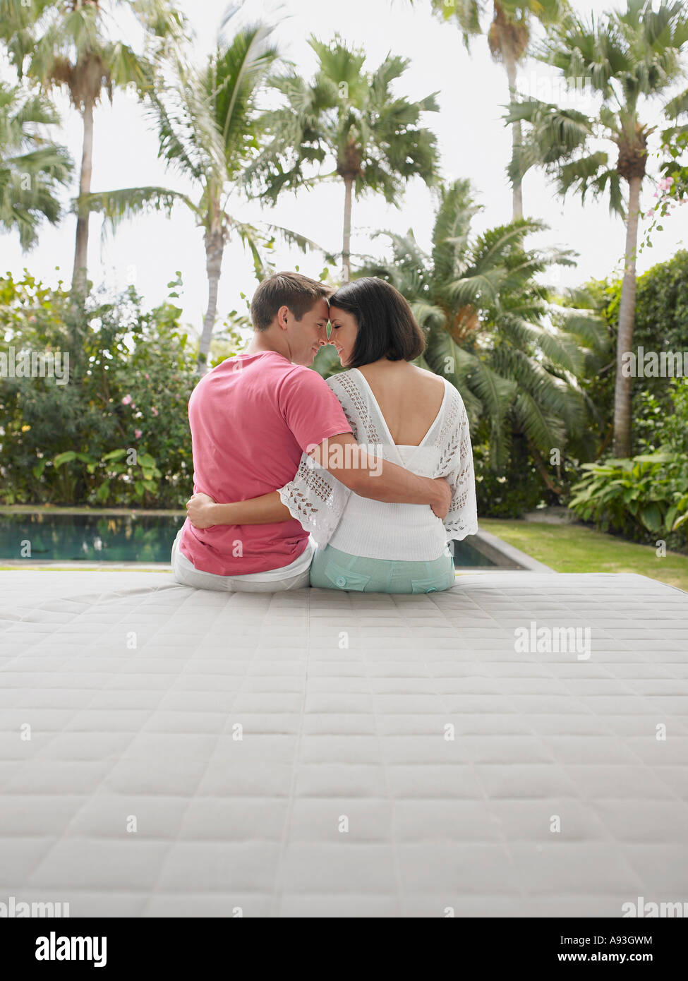 Affectionate Young Couple Relaxing in Garden Stock Photo