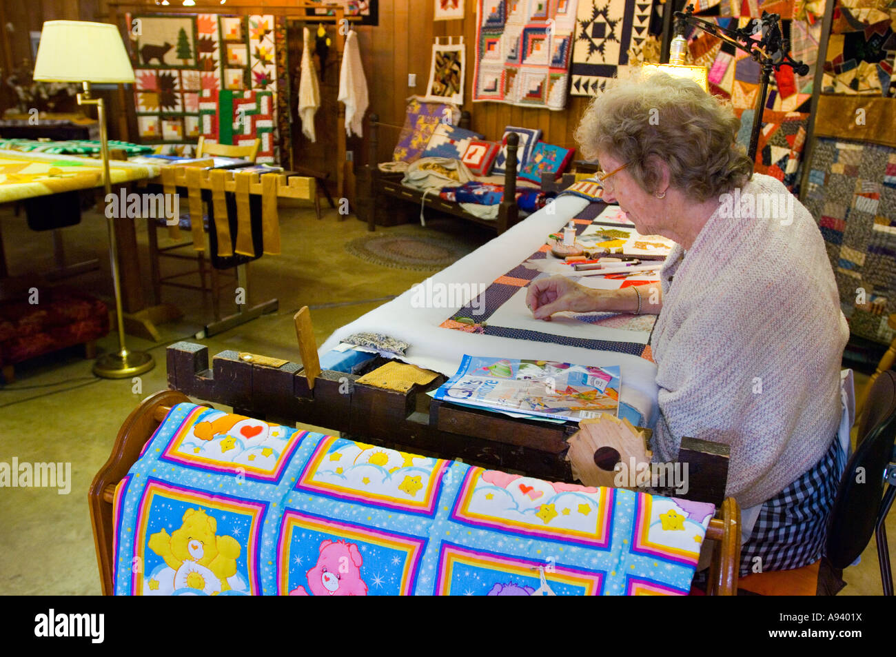 Quilter making quilt in the Crafts Village at the Ozark Folk Center State Park Mountain View AR - Stock Image