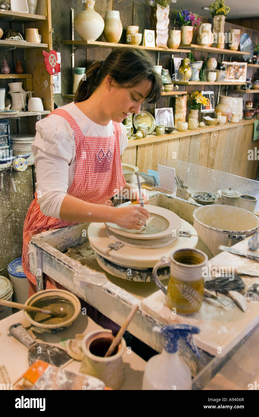 Potter making traditional pottery in the Crafts Village at the Ozark Folk Center Mountain View Arkansas - Stock Image