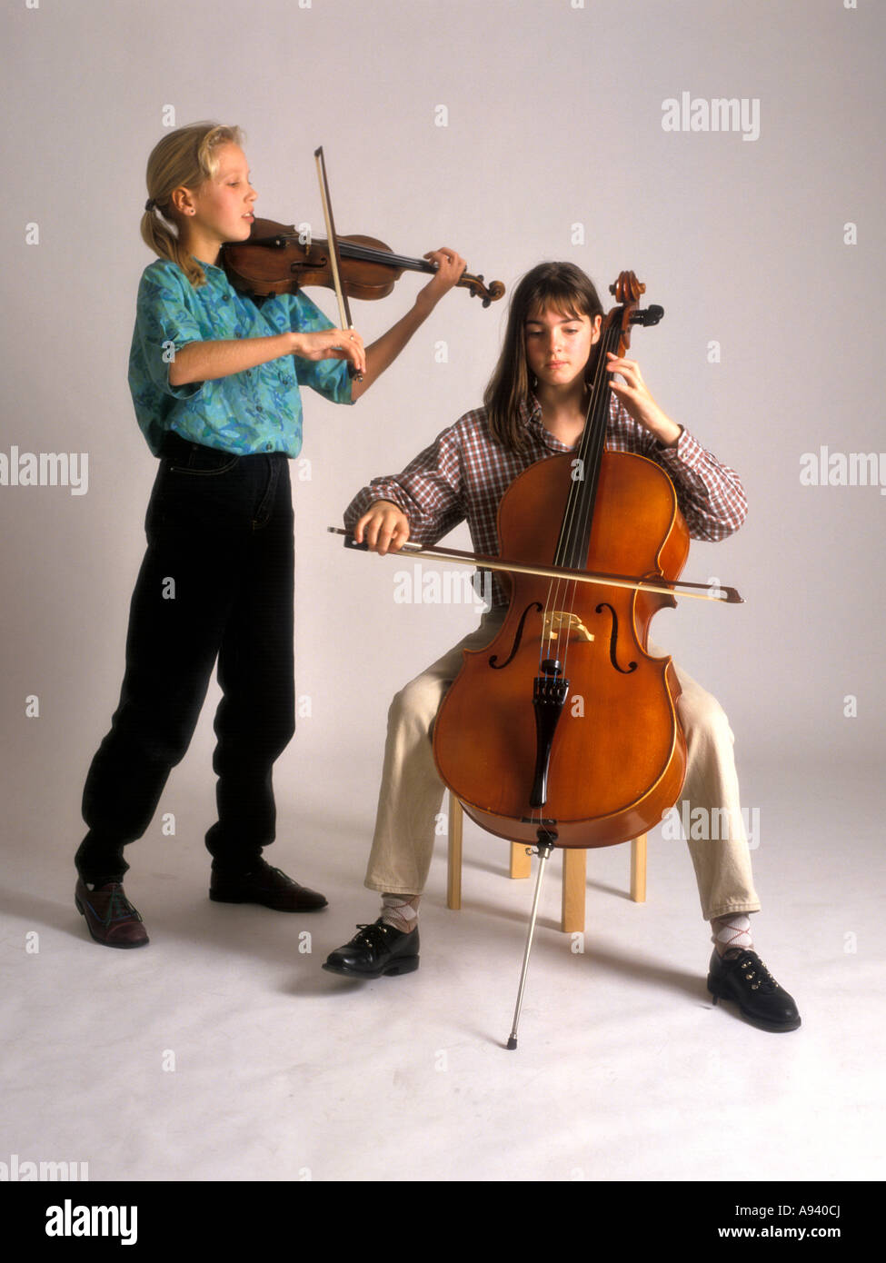 Girl duo is making music - Stock Image