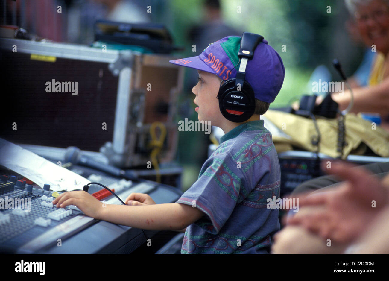 Little boy with a music mix panel - Stock Image