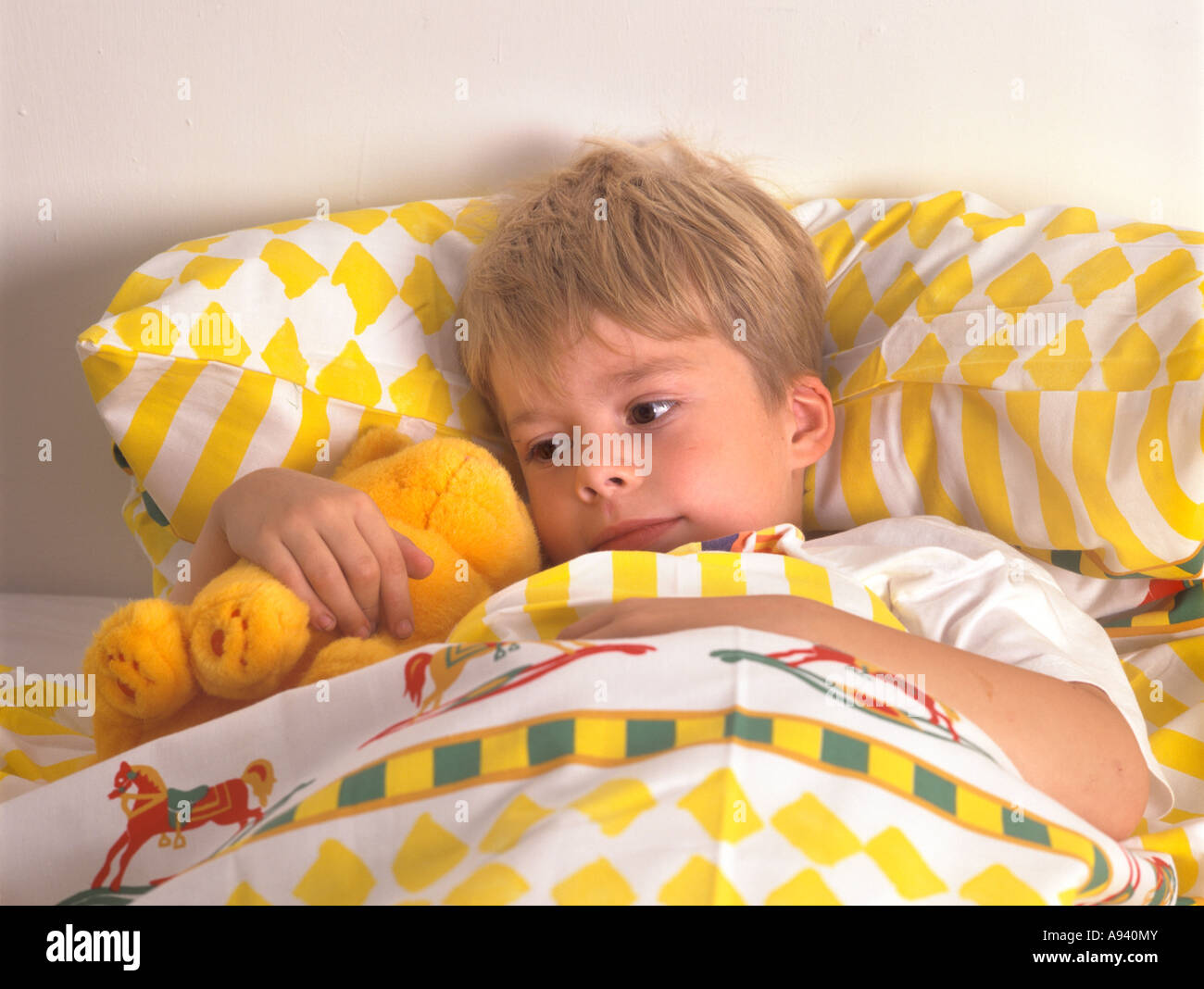 little boy beds boy awake in bed with his pet stock photo 29537