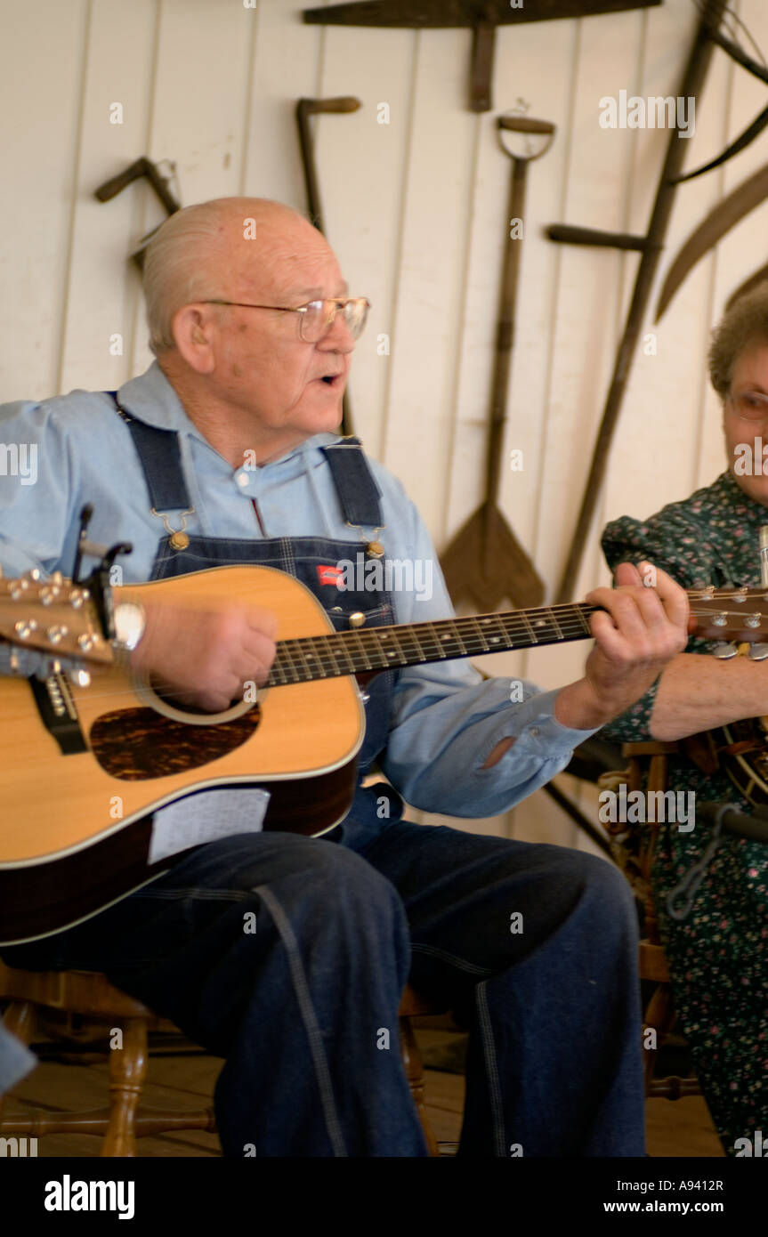 Folk musician performing at a concert at the Ozark Folk Center State Park Mountain View AR - Stock Image