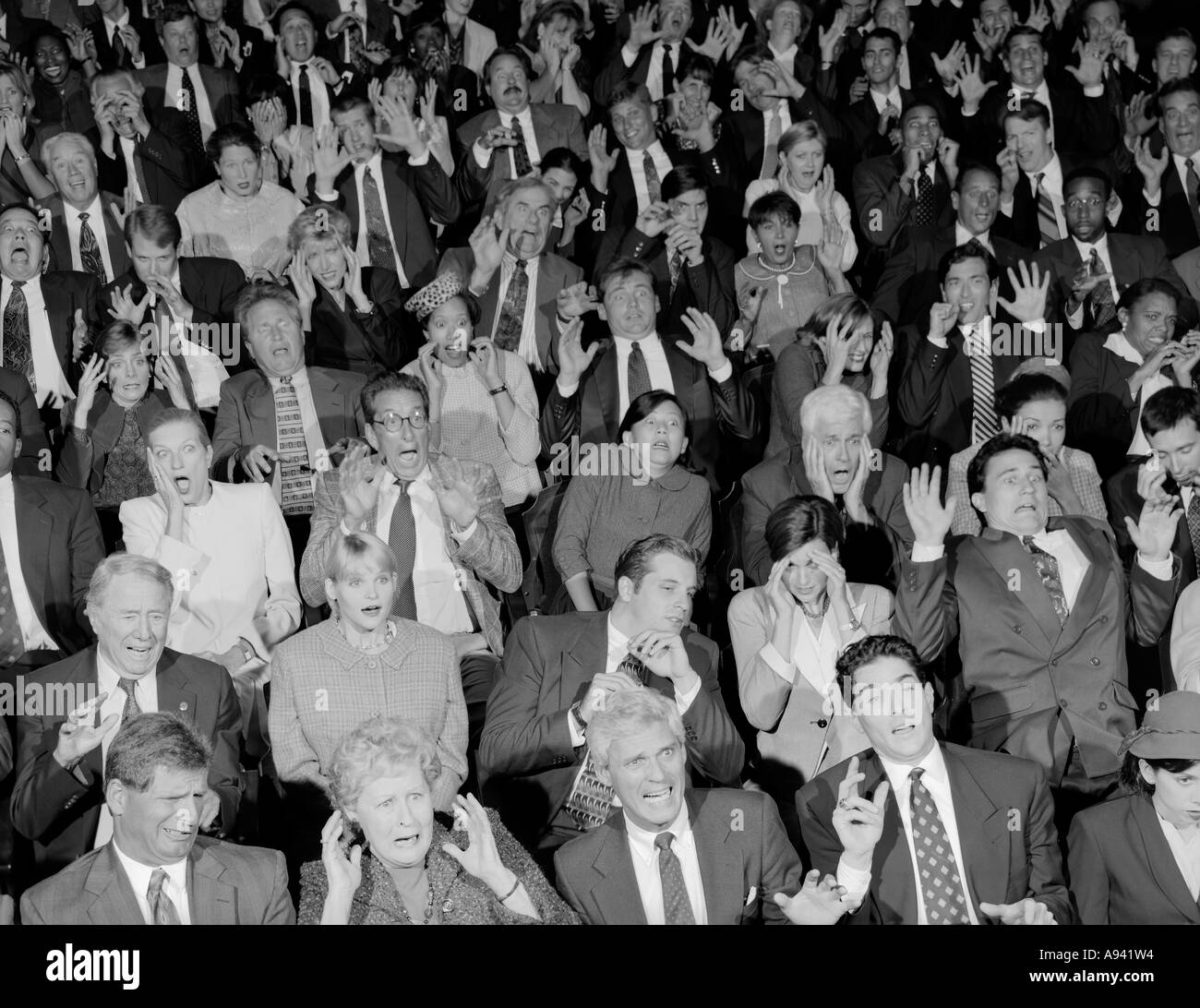 High angle view of audience looking surprised - Stock Image