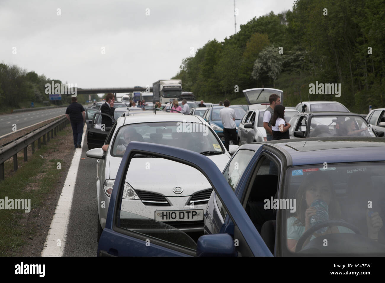 People delayed by large traffic jam following a road