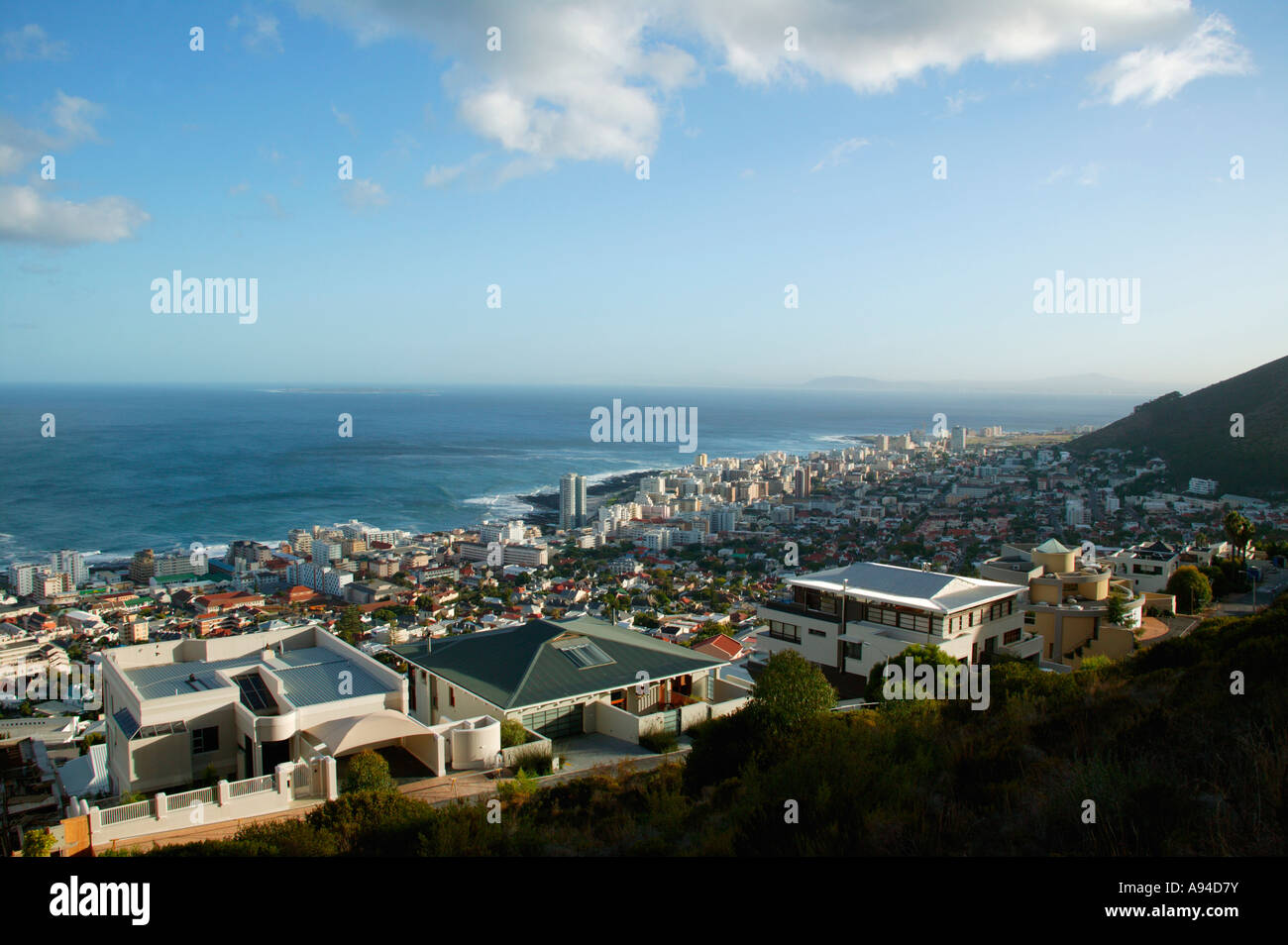 A view over the suburbs of Cape town Atlantic Seaboard towards the sea Cape Town Western Cape South Africa - Stock Image