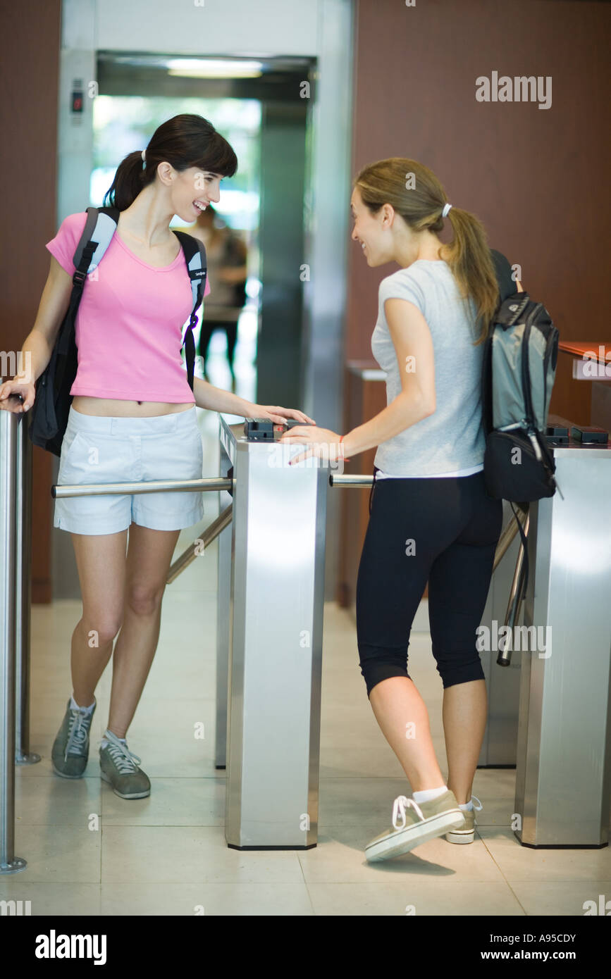 Young women entering health club - Stock Image