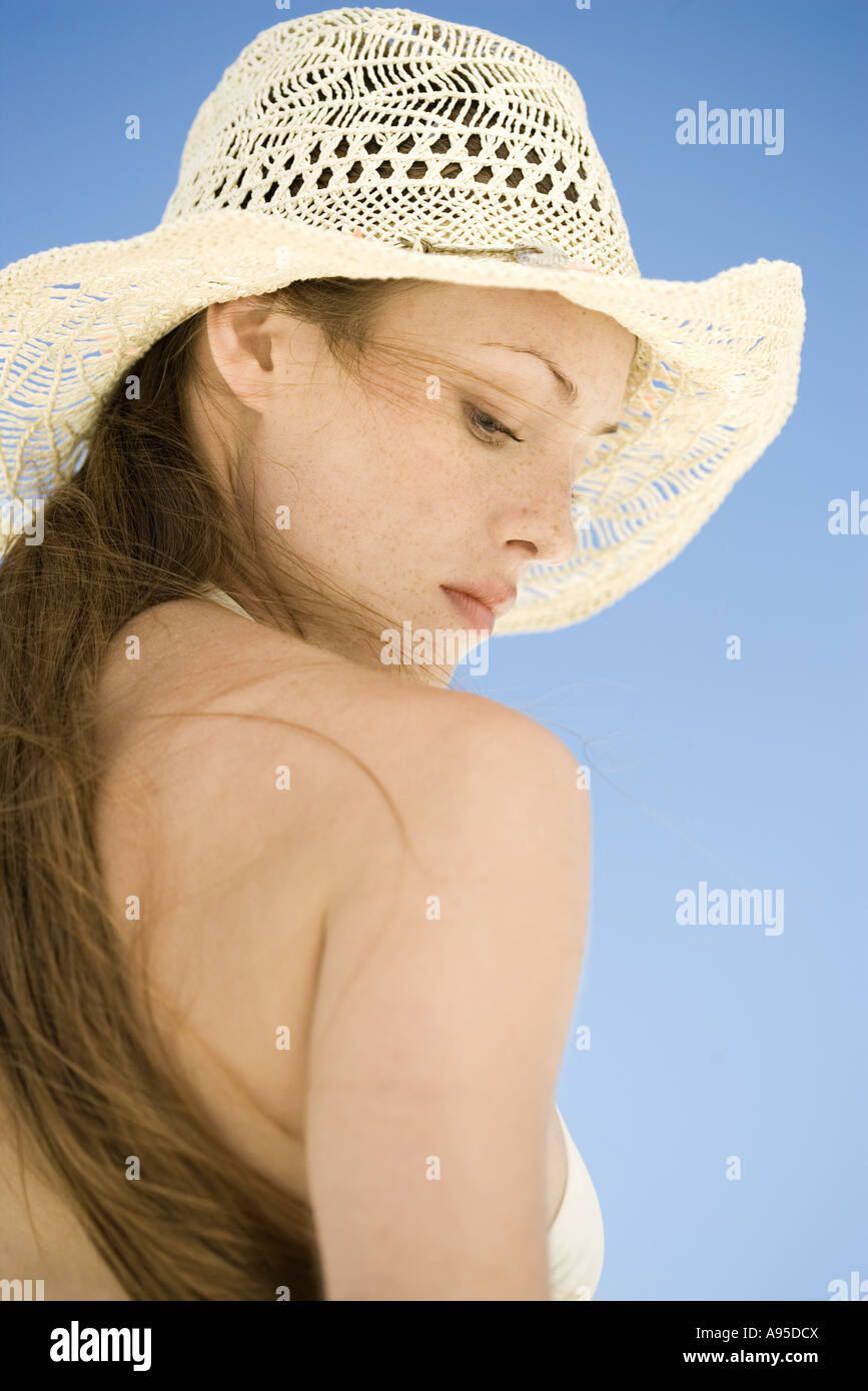 Woman wearing straw hat, low angle view - Stock Image