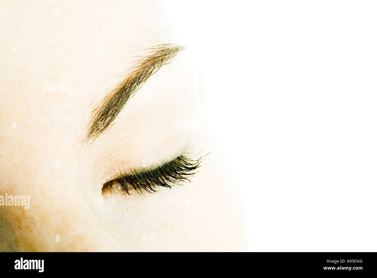 Female's closed eye - Stock Image