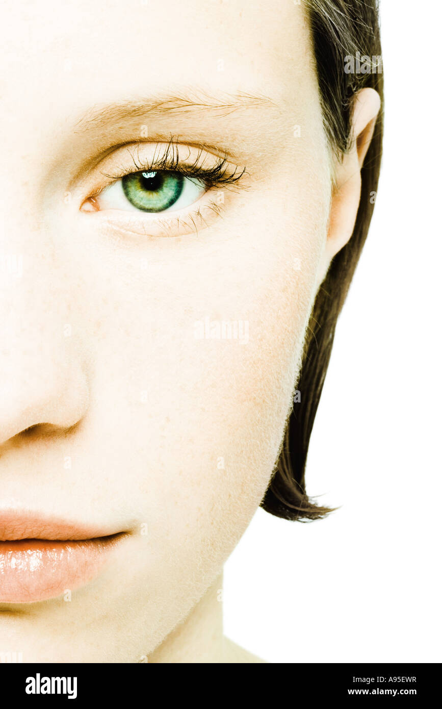 Teenage girl's face, cropped front view - Stock Image