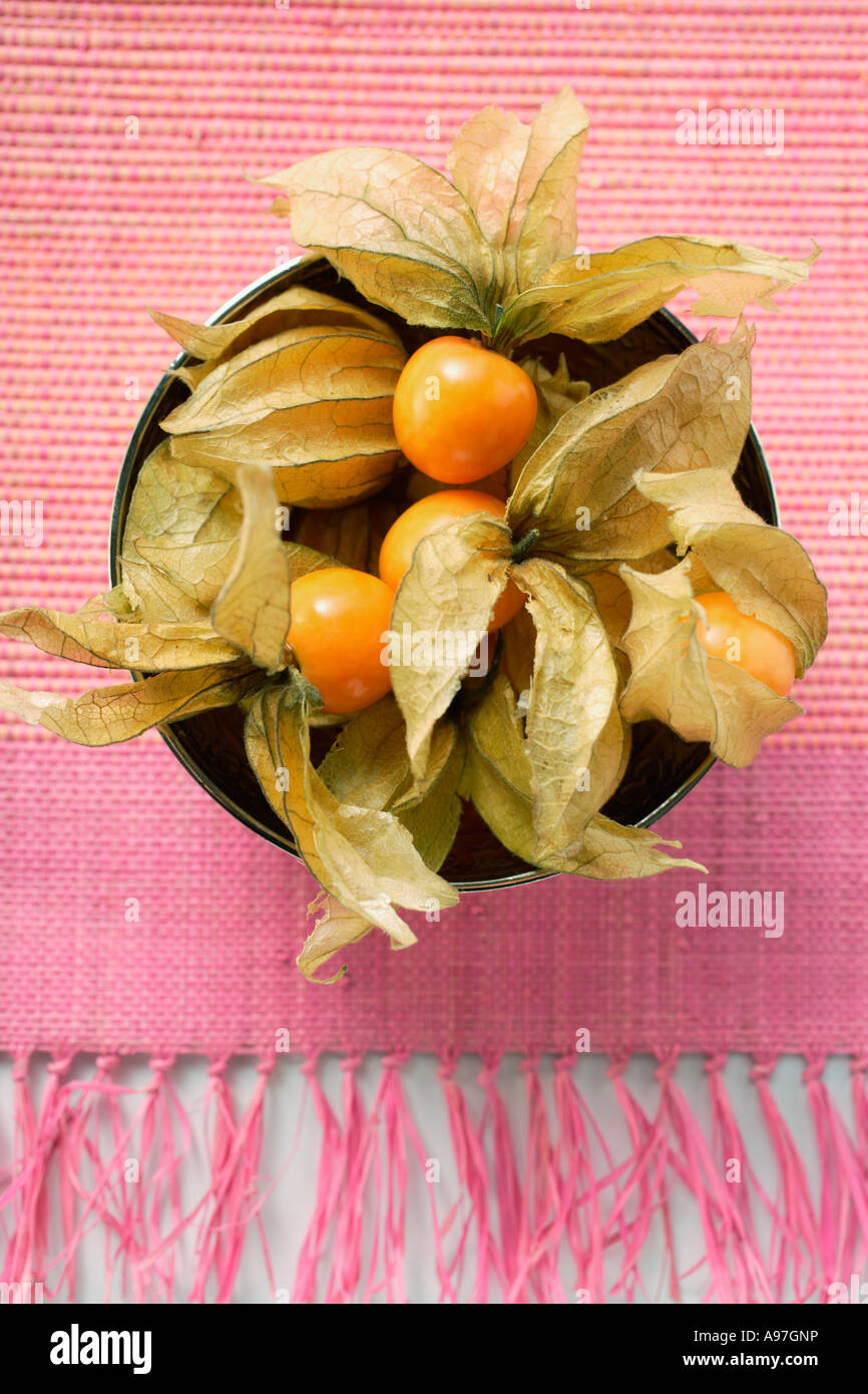 Physalis with calyxes in a bowl FoodCollection - Stock Image