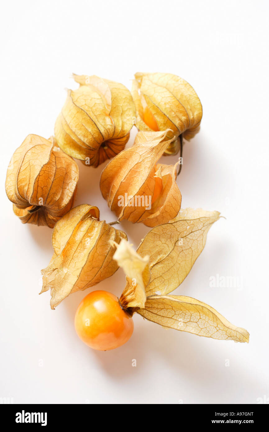 Physalis with and without calyxes FoodCollection - Stock Image