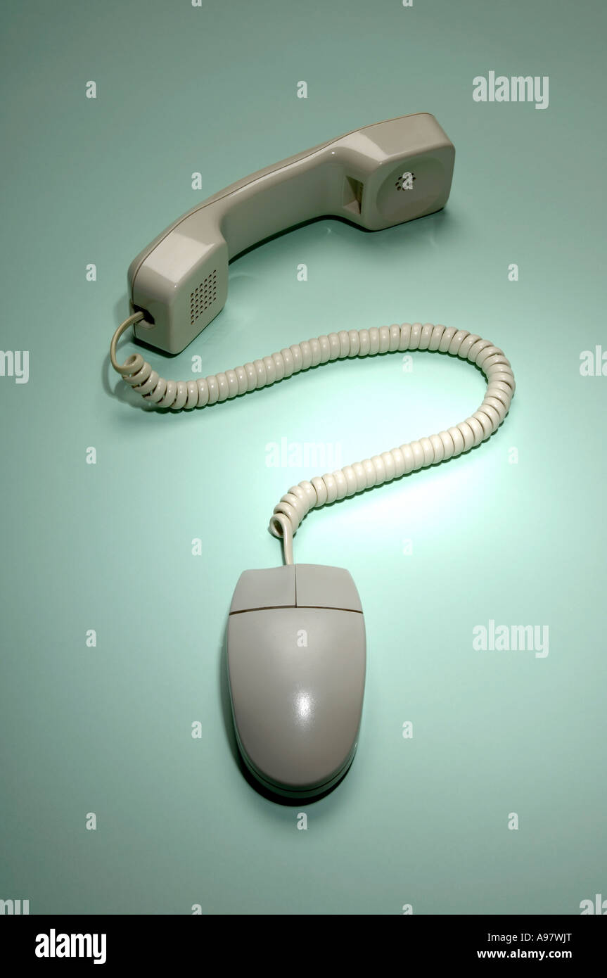 Telephone and computer mouse - Stock Image