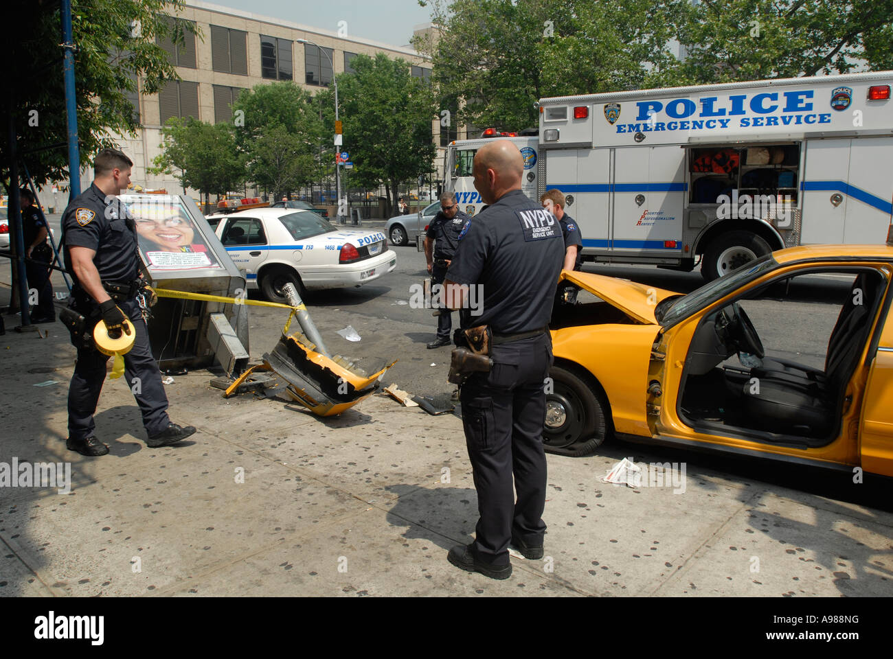 NYPD officers at the scene of a taxi accident Stock Photo