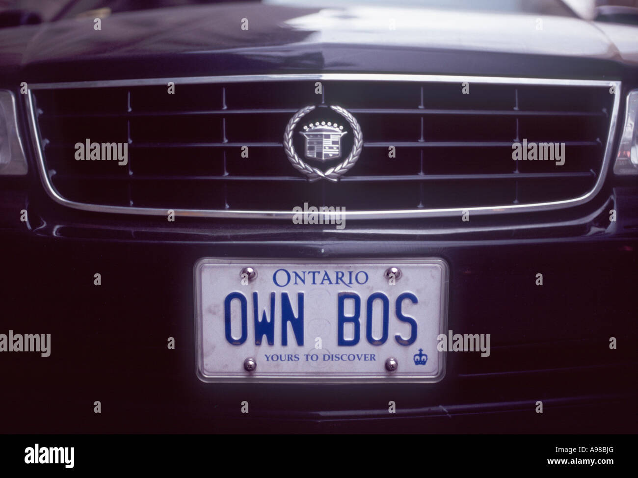 Own Boss: Personalised licence plate on front of Cadillac car Stock ...