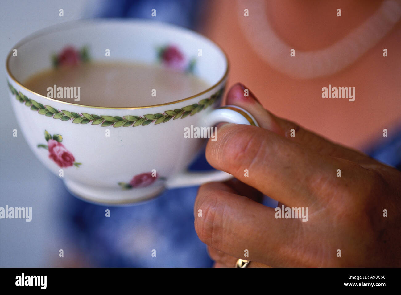Food, Woman drinking tea - Stock Image