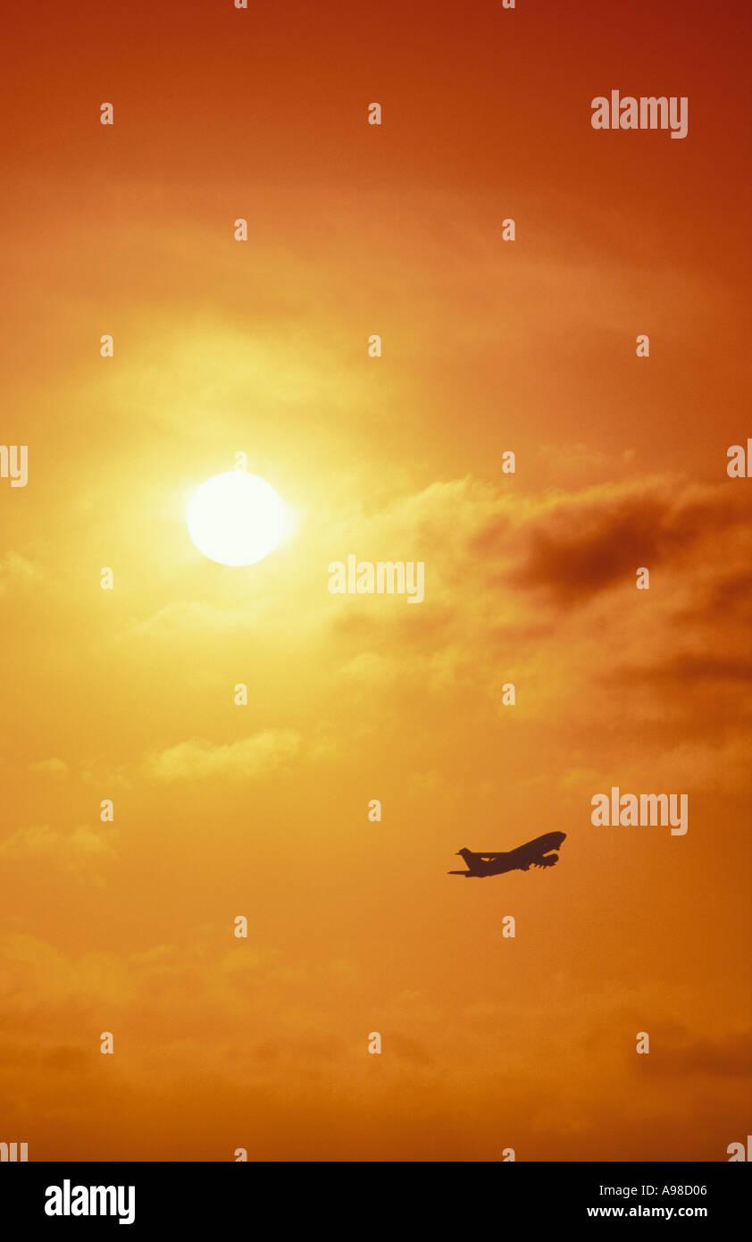 Aeroplane in flight at sunrise Heathrow London England UK - Stock Image